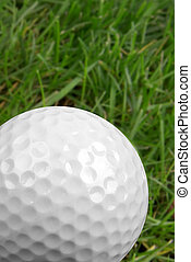 Golf ball close-up from the ground level with grass