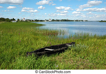 View of ancient russian town Kargopol, destroyed wooden boat...