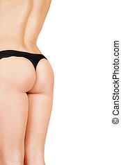 Bum - Back and bum of tanned athletic woman inblack thongs,...