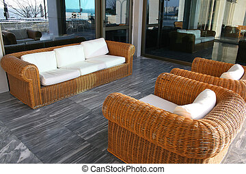 Bamboo sofa - Bamboo outdoors sofa with several white...