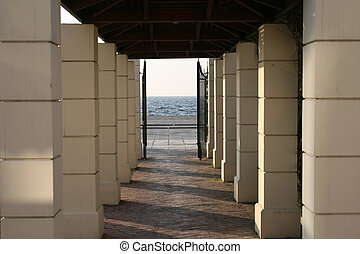 Way out - A small corridor under several columns out to the...