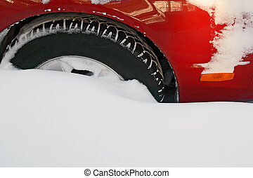 Car wheel stuck in the deep snow after the heavy snowstorm