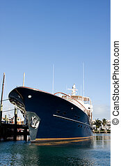 blue luxury yacht - blue hull luxury motor yacht tied to...