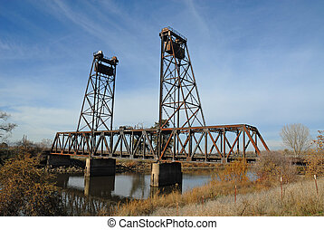 Drawbridge - Railroad drawbridge on a winter morning,...