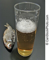 Beer and fish - Dry fish near the glass of beer