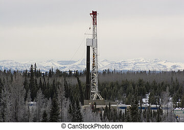 Drilling rig working in the Alberta foothills
