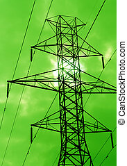 Green Power - The silhouette of power lines agains a green...