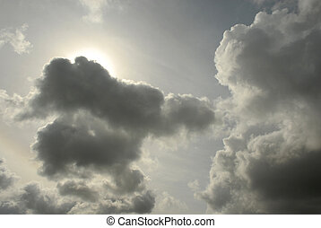 dramatic clouds - dramatic cloudy sky with sun starting to...
