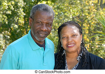 happy mature couple - ethnically diverse mature couple,...