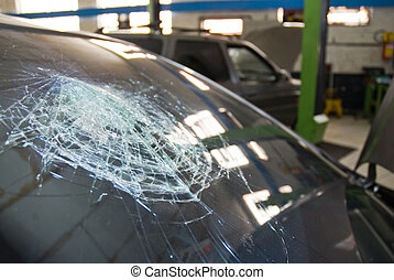 Shattered windshield. - Detail shot of a shattered car...
