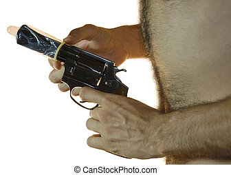 Gun with Condom - Cropped shot of a male hand holding a .38...