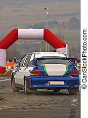 Rally action - Rally car during the race in a curve.Shot...