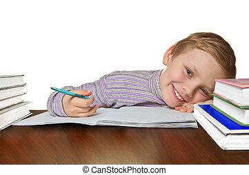 Boy doing homework - Smiling boy doing homework, isolated on...