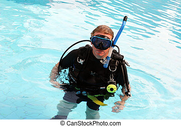 Scuba diver - Man in scuba gear in a swimming pool.