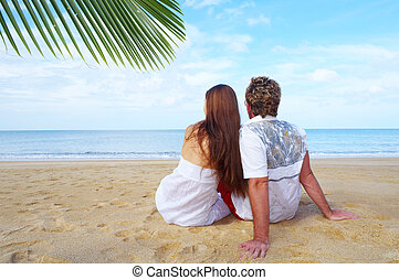 two and ocean - a portrait of attractive couple having date...