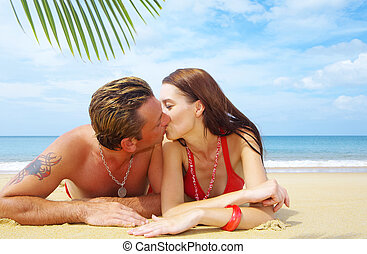 tropic kiss - a portrait of attractive couple having kiss on...