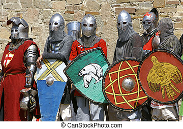 several knights on stone wall background