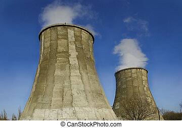 smoking chimneys on blue sky background