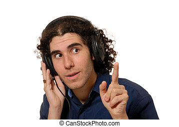 recording studio cue - young man listening to headphones,...