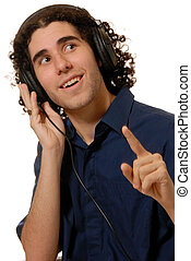 listen to the beat - young man listening to headphones,...