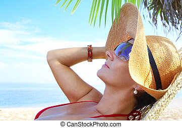 tropic relaxation - view of nice woman lounging in hammock...