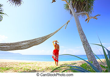 tropic holiday - View of nice woman in red sarong in...