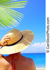 sunny day - view of female in sailor-hat on a background of...