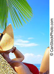 equator lounge - view of nice woman lounging in hammock in...