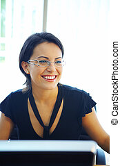 wide smile - view of nice operator in stylish glasses at her...