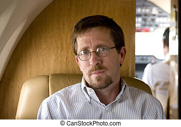 Business Executive Smiling on Plane