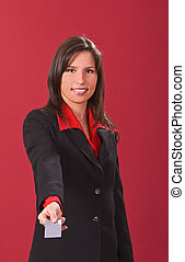 Businesswoman offering a credit card - Image of a...