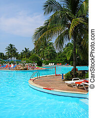 poolside - Resort pool with net and loungers at poolside in...