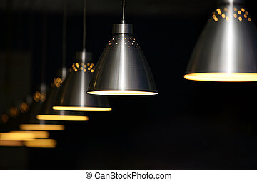 Metal lamps - Many metal lamps at dark restaurant