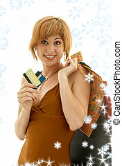 consumer girl with snowflakes - pretty girl with credit...