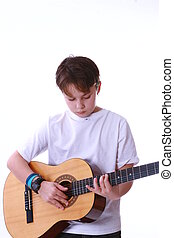 playing guitar - a child learning to play the acoustic...