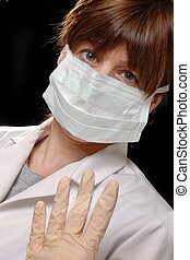 masked with latex gloves - cute young lady doctor / nurse,...