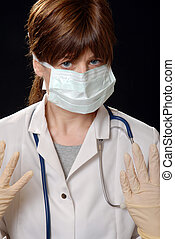 masked with latex gloves - cute young lady doctor, masked...