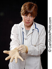 nurse with latex gloves - cute young lady nurse or doctor...
