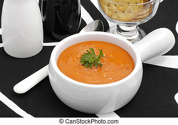 Soup - Roasted red pepper soup in a white bowl.