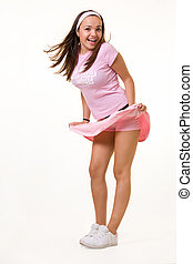 Wind blown skirt - Full body of an attractive young woman...