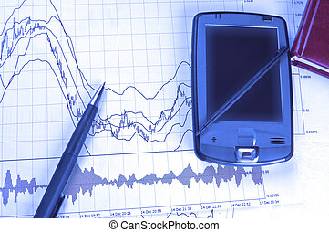 PDA and pen on stock chart - PDA and pen on Forex chart in...