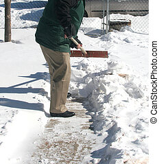 Shoveling Snow - Homeowner shoveling snow on front walkway...