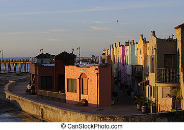 colorful homes on the esplanade in Capitola, California -...