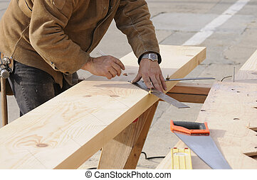 Carpenter marking out steps on a stringer - Carpentermarking...