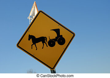 Amish road sign against colorful blue sky