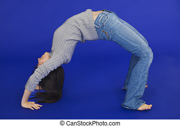Asian Teen - Female Asian teen doing a backbend on a blue...