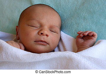 Contented Baby - Week old baby boy on a blue blanket early...
