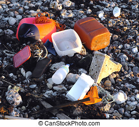 Plastic rubbish on beach - Coloured plastic artifacts and...