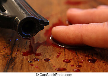 blood, pistol and death - hand of teenager who committed...