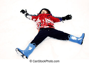 Snow angel - A happy kid playing in the snow as a snow angel
